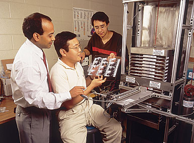 photo of students and professor workinig in a lab