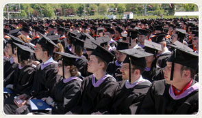 photo of graduates in their robes during commencement ceremony