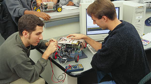 2 students building car